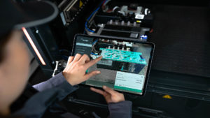 Merging the physical world of machinery and equipment with digital work content